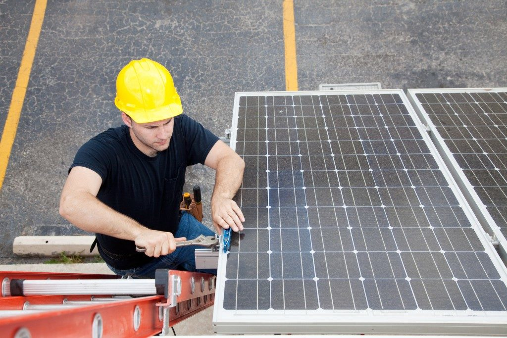 engineer installing portable solar panel