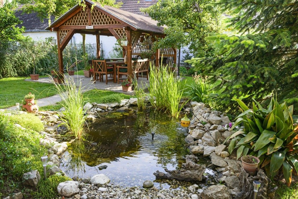 Beautiful Garden With Bench And Little Pond