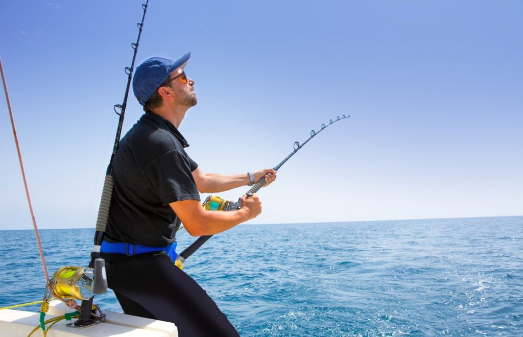 man fishing in a boat